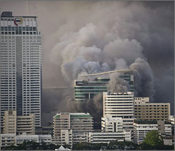 Smoke billows from a commercial area of Bangkok on Wednesday where Red Shirt demonstrators had their camp in downtown Bangkok.