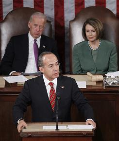 Mexican President Felipe Calderon addresses a joint meeting of Congressl in Washington on Thursday as House Speaker Nancy Pelosi (D- Calif.) and Vice President Biden, left, listen.