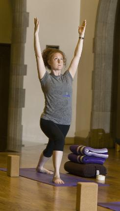 Emily Dimon practices a yoga post.
