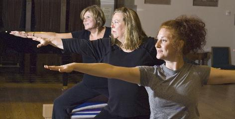 Cancer survivors, from left, Jan Hill, Suzanne Slack and Emily Dimon from the Rochester, N.Y., area, take a gentle yoga class. They did not participate in the study.