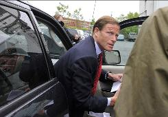 Connecticut Attorney General Richard Blumenthal arrives for a Tuesday news conference.