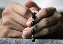 The Vatican is investigating whether 19 congregations of sisters and nuns have been in line with Church expectations, like this faithful Catholic praying the rosary.