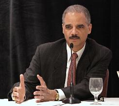 U.S. Attorney General Eric Holder responds to a question from a member of the audience after speaking at a meeting of the California Cities Gang Prevention Network in Sacramento, Calif., Monday, May 10.