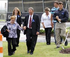 Attendees leave Tuesday's memorial service at the Jackson Convention Center in Mississippi.