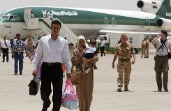 In this 2005 photo, people arrive at Basra airport. Iraq's government has dissolved state-owned Iraqi Airways because it is bankrupt.