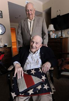George O'Connell, 96, seated, and Bob Murphy, 89, both World War II veterans, met at a continuing care community in Atlanta where they both live.