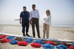 President Obama, LaFourche Parish president Charlotte Randolph, right, and U.S. Coast Guard Admiral Thad Allen, National Incident Commander for the BP Deepwater Horizon oil spill, look Friday at booms laid out to collect oil during a tour of areas impacted by the Gulf Coast oil spill.