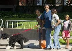 President Obama takes a walk with his mother-in-law, daughters and dog near his home in Chicago, where the first family is spending Memorial Day weekend.