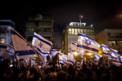 Israelis rally in Tel Aviv to support their country following a military encounter at sea that left nine dead.