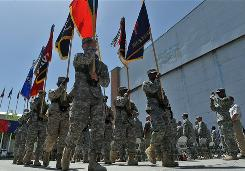 Soldiers carry flags Monday during a ceremony at Bagram Air Base that commemorated Memorial Day.