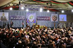 Delegates listen as Afghan President Hamid Karzai delivers a speech to open the conference in Kabul on Wednesday.