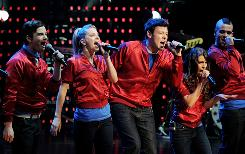 Stars of Glee, from left, Chris Colfer, Dianna Agron, Cory Monteith, Lea Michele and Mark Sellig, perform at the Gibson Amphitheater on May 20 in Universal City, Calif.