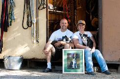 "David ""Woody"" Bartley and his wife Deanna sit with dogs Harmony and Bowtie at A Chance for Bliss, the sanctuary for older pets and barnyard animals they established in 2000."