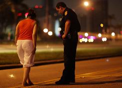 A Miami police officer conducts a field sobriety test at a DUI traffic checkpoint. A new survey shows Americans support sobriety checkpoints and other safety measures such as traffic cameras and motorcycle helmet laws.