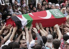 The coffin of a victim of the Israeli naval commando raid is carried at the end of the religious funeral service at the Fatih mosque in Istanbul.