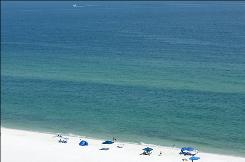 The water remains clear and the beach pristine on Wednesday along Pensacola Beach, Fla. Until the well from the Deepwater Horizon rig is capped, Florida's beaches remain under threat.