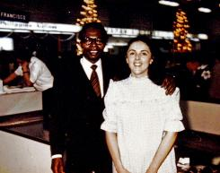 "President Obama's father, also named Barack Obama, stands with his mother Stanley Ann Dunham at an airport in Hawaii. In 1961, when they married, less than 1 in 1,000 new marriages mirrored theirs  far less than the 1 in 7 that do now. Still, the idea ""that we're post-racial after Obama got elected is not true,"" says Iijima Hall, a psychologist who has studied interracial marriage."
