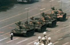 A Chinese man stands alone before a line of tanks in Beijing's Tiananmen Square, June 5, 1989.