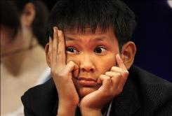 Vothom Son Lu, 11, of Camden, N.J., listens to fellow competitors Thursday while on stage at the Scripps National Spelling Bee in Washington.