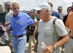Florida Governor Charlie Crist and entertainer Jimmy Buffett walk along Pensacola Beach, Fla., on Saturday, June 5.
