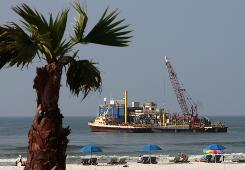 Booming operations continue off the coast of Orange Beach, Ala., June 7. From the early 1970s through the '90s, offshore rigs and pipelines averaged about four spills per year of at least 50 barrels.