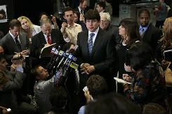 Former Illinois governor Rod Blagojevich and his wife, Patty, speak with reporters after arriving at federal court Tuesday in Chicago.