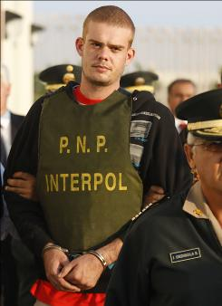 Joran Van der Sloot, seen here June 4, is escorted by police officers outside a Peruvian police station, near the border with Chile in Tacna, Peru. Peruvian police said Tuesday van der Sloot confessed to killing a young woman in his Lima hotel room last week.