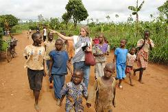 Teegan Bukowski learns Kinyarwanda, the language in Rwanda, from village children and in turn teaches them English.