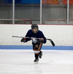 Kyle Peters, age 8, tries to maintain his balance, holding his stick across his arms in Pennsauken, N.J.
