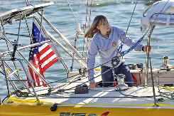 Abby Sunderland, 16, looks out from her sailboat, Wild Eyes, as she leaves for her world record attempting journey at the Del Rey Yacht Club in Marina del Rey, Calif., on Jan 23.