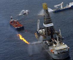 Activity at the site of the Deepwater Horizon oil spill in the Gulf of Mexico off the Alabama coast is seen from a Coast Guard plane Thursday.