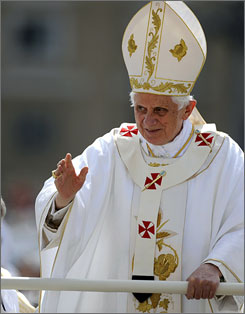 Pope Benedict XVI waves as he arrives in Saint Peter's Square at the Vatican before a Mass on Friday.
