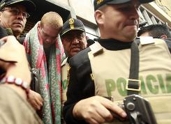 Joran van der Sloot, second left, is escorted by police officers in Lima on Friday after being ordered into prison to await a murder trial.