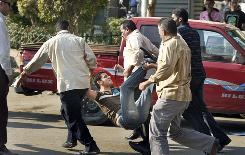 An Egyptian man, who allegedly was beaten, is dragged off by plain-clothed policemen at a demonstration protesting against police brutality in Cairo, Egypt, Sunday.