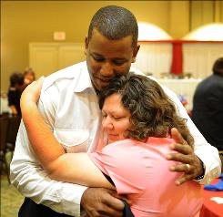 U.S. Rep. Kendrick Meek hugs Beth McMillen at a Melbourne, Fla., campaign stop to win the Democratic nomination for a U.S. Senate seat. He has an Aug. 24 primary before November's general election.