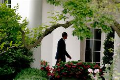 President Obama walks to the Oval Office at the White House prior to his Tuesday address.