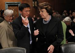 Goodwin Liu talks with Senate Judiciary Committee member Sen. Dianne Feinstein on Capitol Hill in April, prior to testifying on his nomination to the U.S. 9th Circuit Court. Liu would be the only Asian on that bench.