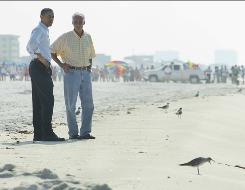 President Obama, left, and Fla. Gov. Charlie Crist look at the shoreline of Pensacola Beach before a briefing with local officials on the BP oil spill Tuesday in Pensacola, Fla.