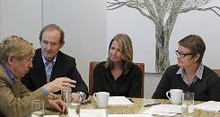 Attorneys Ted Olson, left, and David Boies speak Tuesday with plaintiffs Sandy Stier and Kris Perry in San Francisco.