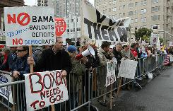 Members of the Tea Party movement protest outside the Fairmont Hotel before President Obama arrives for a fundraiser May 25 in San Francisco.
