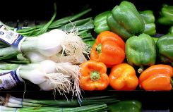 Fresh vegetables on display at a grocery store in Holland, Mich. An advisory committee recommends that Americans shift to a more plant-based diet.