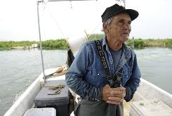 Thomas Gonzalez says that before the spill, a fisherman in St. Bernard Parish could catch $4,000 worth of blue crabs a day. Now, many work on BP's cleanup crews.