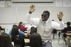 Algebra teacher LaMar Queen wears sunglasses as performs for students at the Los Angeles Academy. He's won two awards for his innovative teaching method: creating rap songs out of math concepts.