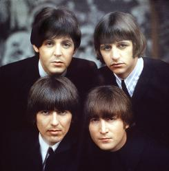 The Beatles, clockwise from top left, Paul McCartney, Ringo Starr, John Lennon, and George Harrison are shown on an album cover in 1965.