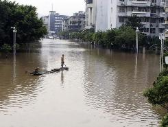 A man on a raft Thursday in a flooded section of downtown Guilin, in southern China.
