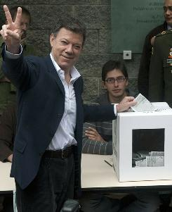 Juan Manuel Santos, a former Columbian defense minister and the presidential candidate for the ruling National Unity party, votes during the presidential election run-off on Sunday in Bogota.