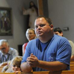 Jason Cox and daughter Kaitlyn attend Mass at St. Anthony Church in Lafitte, La. State lawmakers made Sunday a day of prayer in the state of Louisiana for an end to the Gulf of Mexico oil crisis. The Deepwater Horizon drilling rig exploded two months ago.