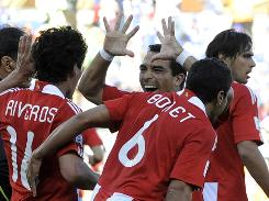 Paraguyan players celebrate during the World Cup match against Slovakia, which Paraguay won 2-0.