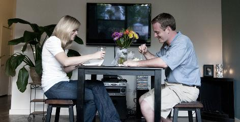 Brittney Locey, left, and James Marsden, her boyfriend of almost 9 years whom she met in high school, enjoy dinner in their Dallas apartment.