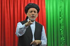 "Afghan President Hamid Karzai speaks at a meeting in Kandahar city, Afghanistan, on Sunday, June 13. Karzai's chief spokesman said the Afghan leader believes Gen. Stanley McChrystal is a person of ""great integrity"" and had displayed a very good understanding of the Afghan people and the Afghan culture."
